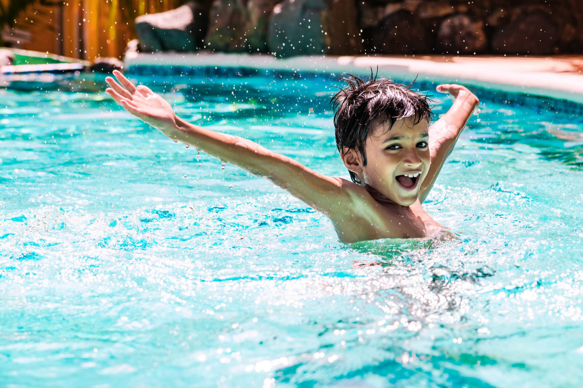 Boy Playing In Remodeled Fiberglass Swimming Pool